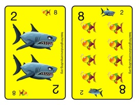 "Image showing 2 of the 12 cards in the ""Ten"" pack of cards. The 2 and the 8 card are shown - both add up to 10. The 2 is represented by a shark, the 8 by little fish (eaten by the shark). There is a predatory-prey relationship between 'opposing' cards that add up to ten."